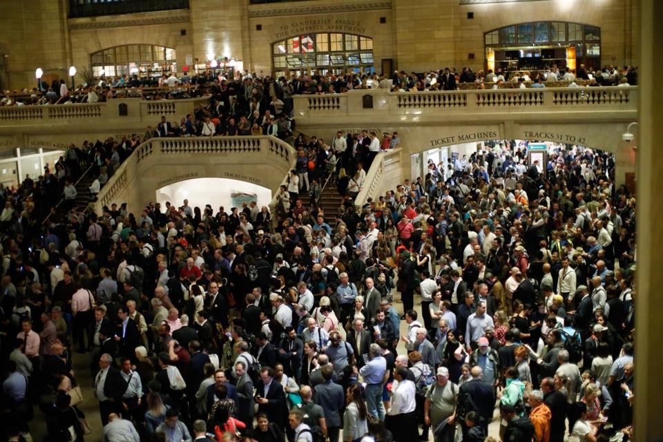 At Grand Central Terminal in New York City, commuters waited for train service to be restored after thunderstorms downed trees and caused power outages.