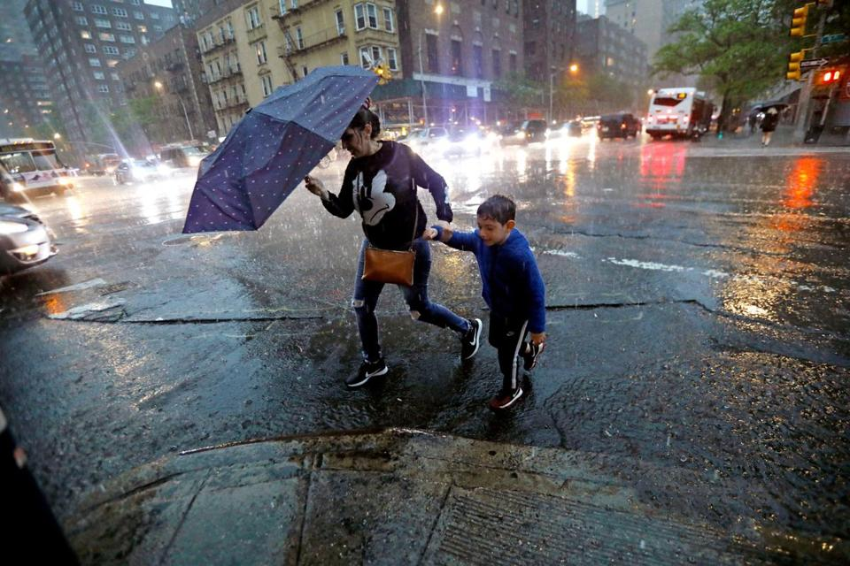 Pedestrians crossed a rain soaked Ninth Avenue in New York City during the storms.