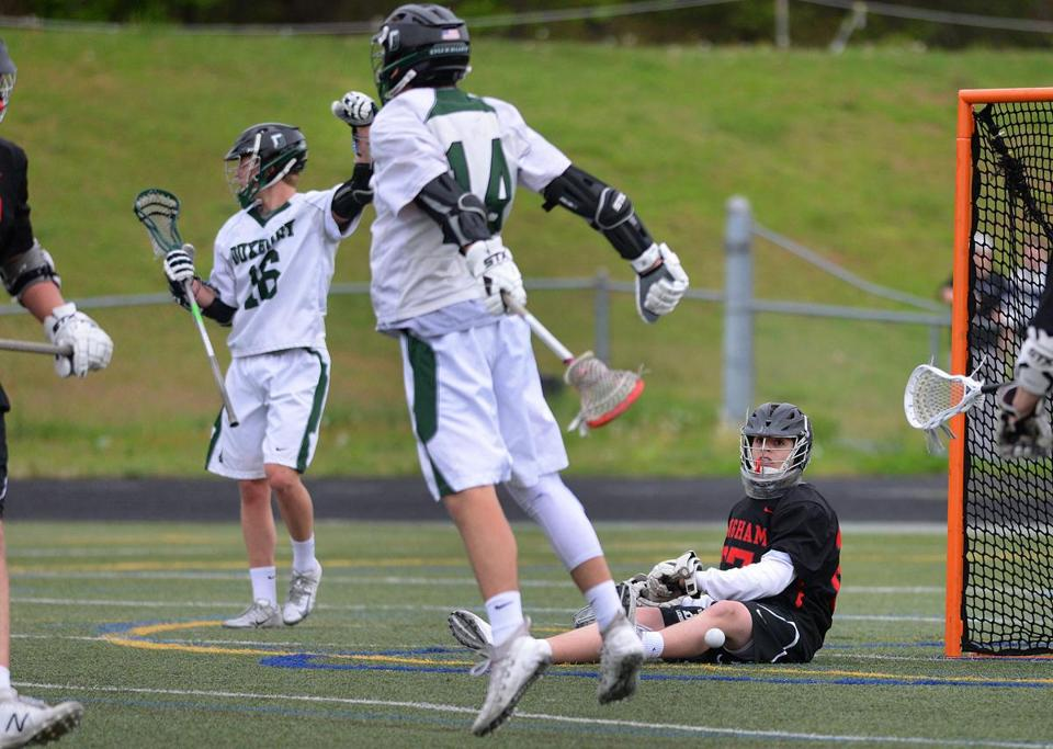 Duxbury- 05/16/18- Duxbury vs Hingham boys lacrosse- Duxbury's Matt Peters(center) jumps up and celebrates his 1st half goal past Hingham goalie George Egan(rt) as Duxbury's Brad Backlund(left) joins in the celebration Photo by Debee Tlumacki for the Boston Globe(sports)