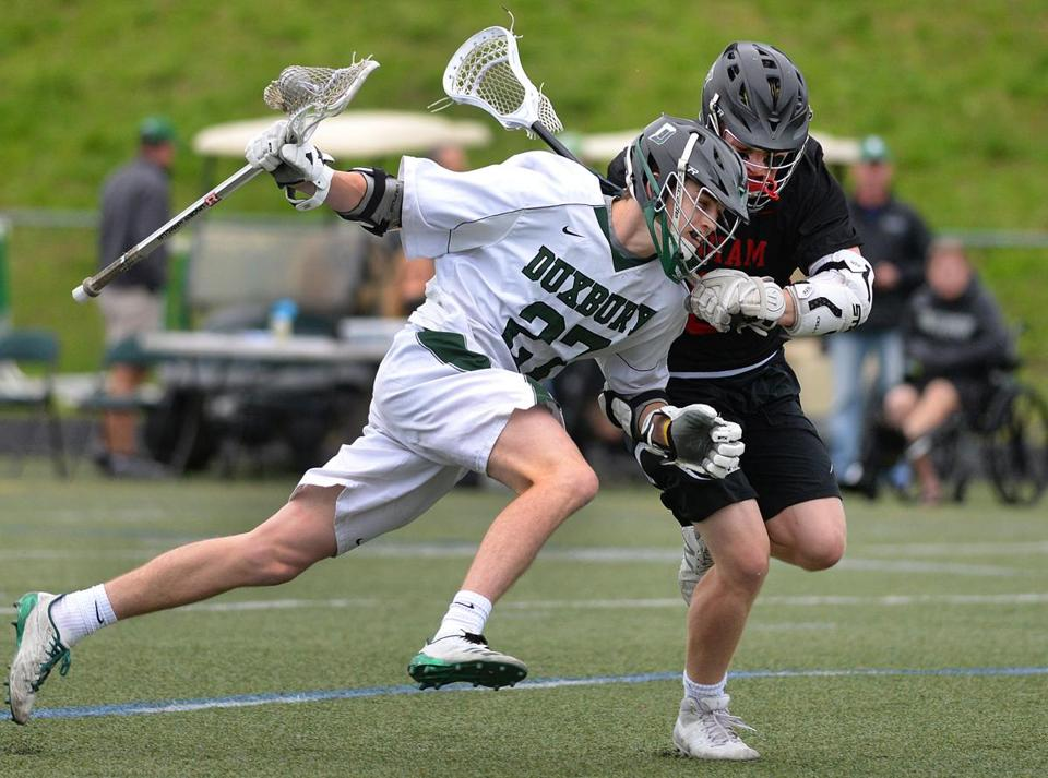 Duxbury's Will Prouty (left) makes a strong drive against Hingham's Jonathan Bearden in the first half of Wednesday's 9-7 win over the top-ranked Harbormen.