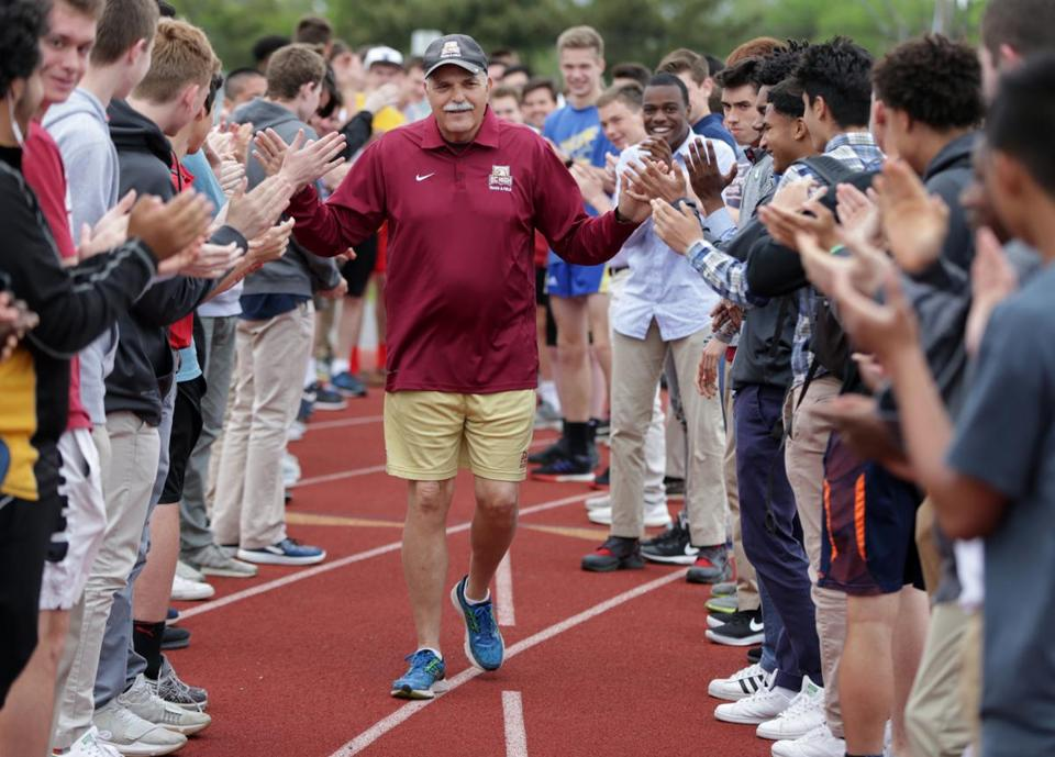 Boston Ma BC High Track and Field Coach John Normant (cq) receives a round of applause as he walks along track. He is retiring from school. Jonathan Wiggs /Globe Staff Reporter:Topic.