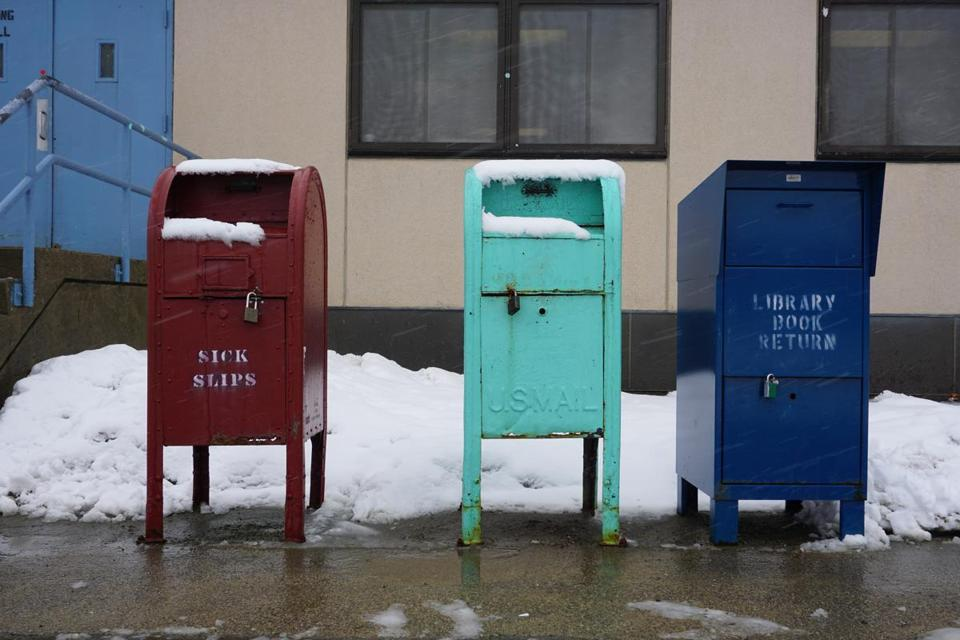 "Mailboxes where inmates input ""sick slips"" to notify the institution they have an ailment."
