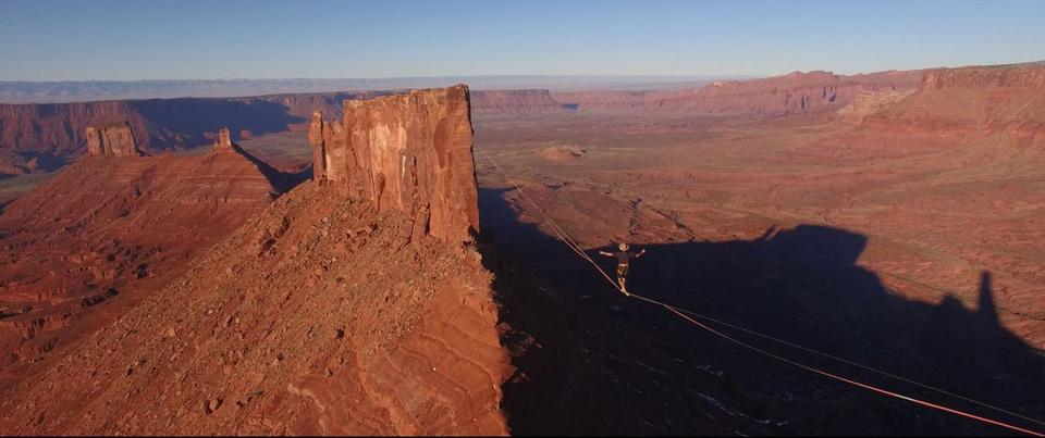"A high-wire walker traverses a canyon in Jen Peedom's documentary ""Mountain."""