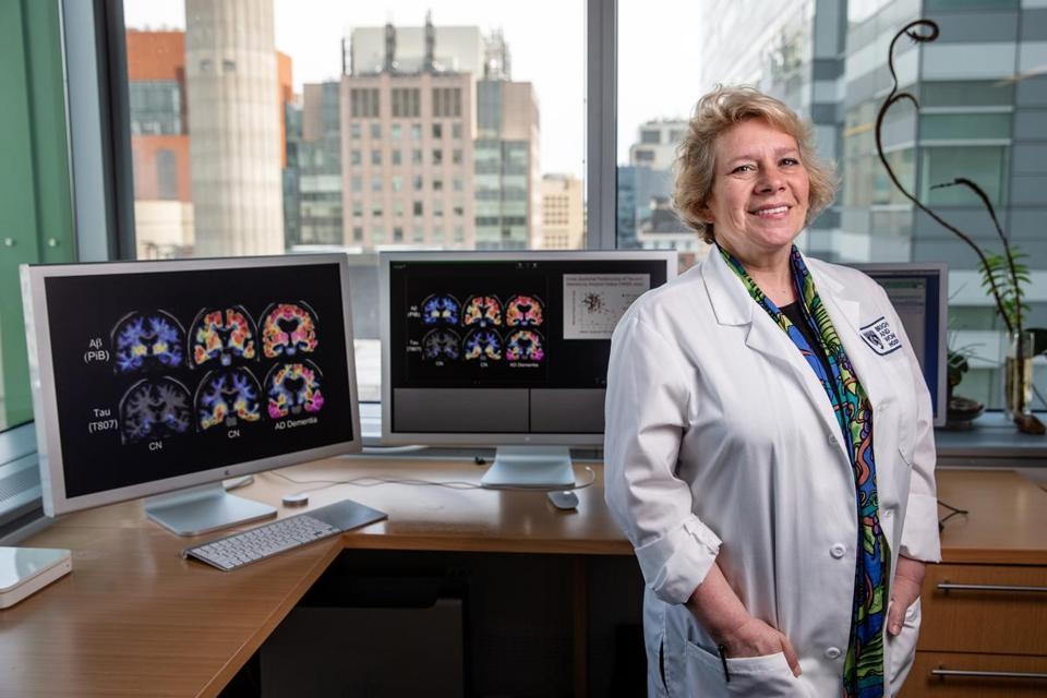 05/16/2018 BOSTON, MA Dr. Reisa Sperling (cq) poses for photos in her office with PET scans on her computer at Brigham and Women's Hospital in Boston. (Aram Boghosian for The Boston Globe)