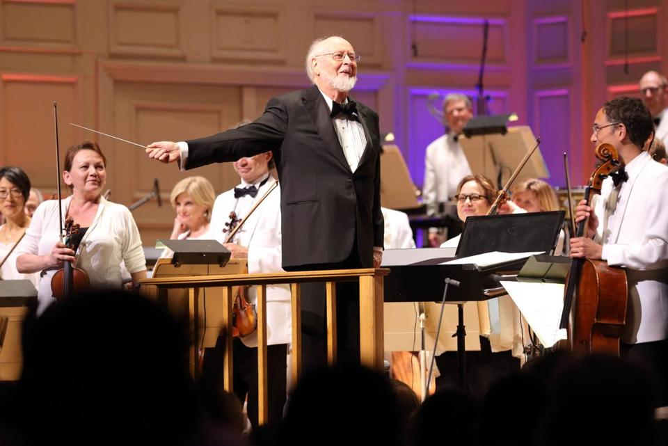 John Williams greeted the Symphony Hall audience before conducting the Boston Pops in a selection of his works Wednesday night.
