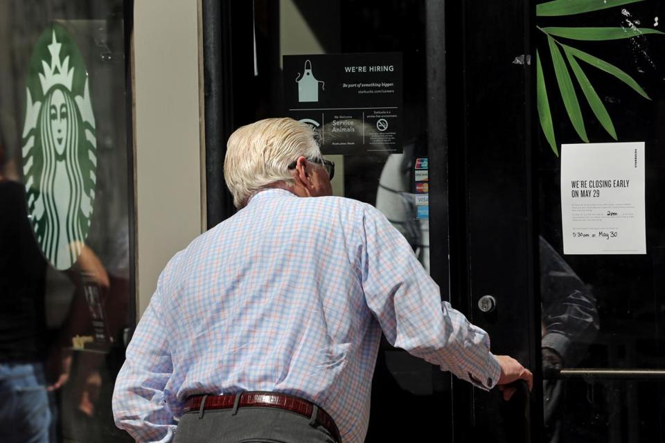 Kevin Costello peered inside the Washington Street Starbucks in Boston while the store was closed on Tuesday afternoon.