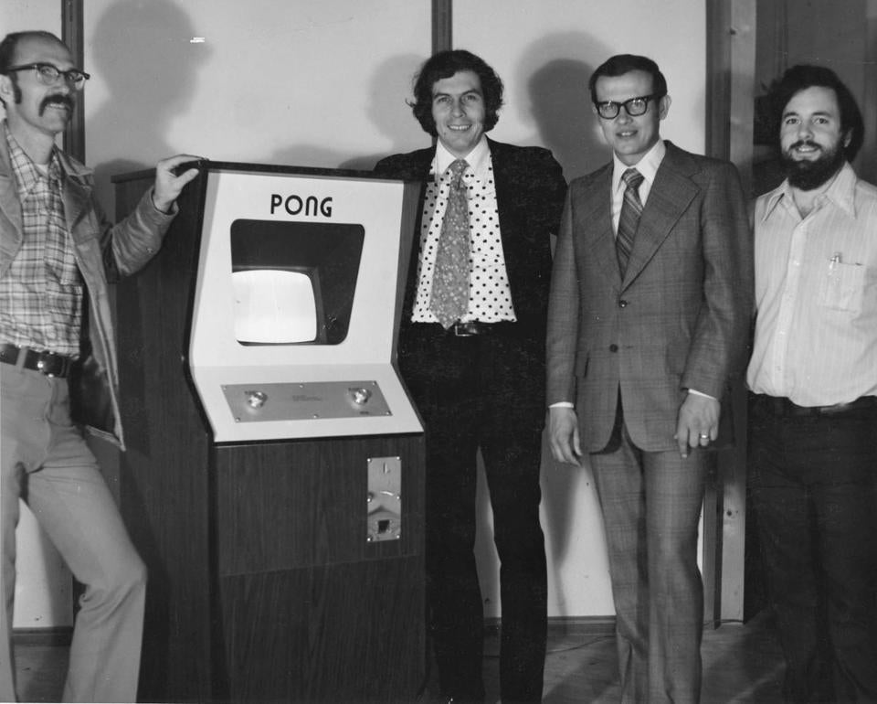 Mr. Dabney (from left), Nolan Bushnell, Fred Marincic, and Allan Alcorn in 1973 with a Pong console at the Atari offices in Santa Clara, Calif.