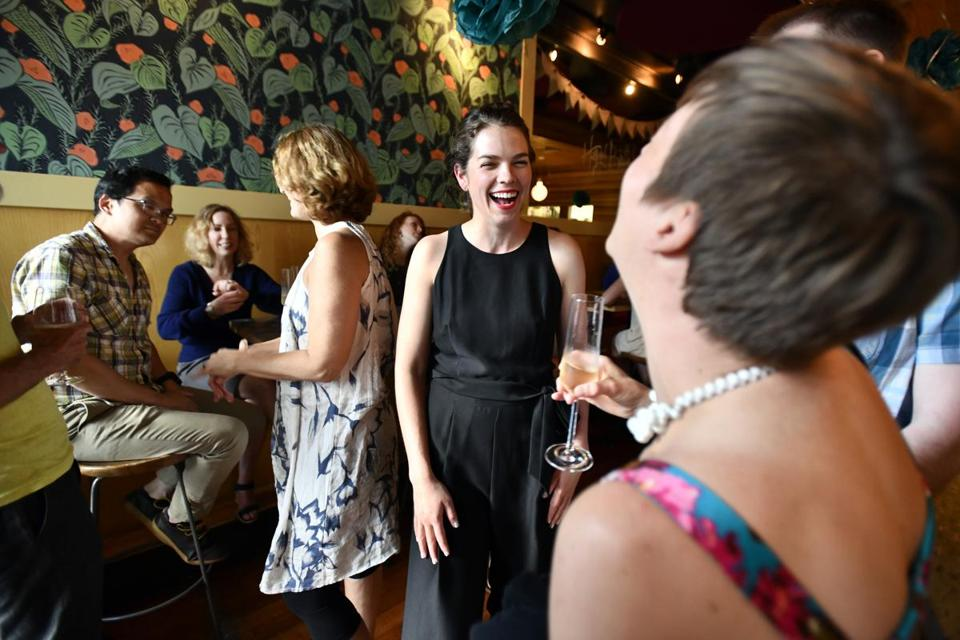 Co-owner Mary Kurth greets friends and patrons during the anniversary party at Spoke Wine Bar, Somerville, reopening a year after the death of the original owner Flea Foster. Josh Reynolds for The Boston Globe (Names, morris)