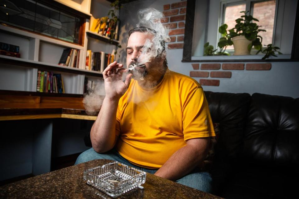 05/30/2018 WORCESTER, MA Member Matt Pavini (cq) smokes marijuana at the Summit Club in Worcester. (Aram Boghosian for The Boston Globe)