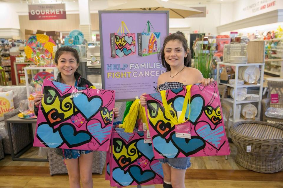 10noinformer -- Sarah Podradchik, right, and her sister, Abby, hold the bags she designed at a HomeGoods store in Allston. (Dana-Farber Cancer Institute)