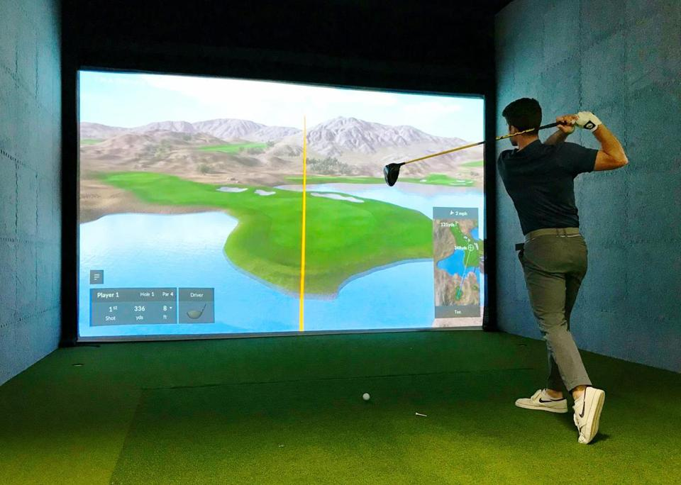 Golf enthusiasts can play the best courses in the world - virtually - in Woburn. (Cummings Properties)