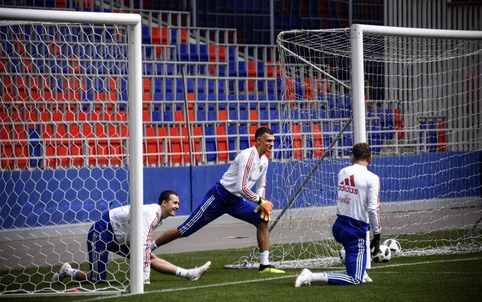 Russia's goalkeepers Andrey Lunyov, Vladimir Gabulov, and Igor Akinfeev at a training session in Moscow ahead of the start of the World Cup.