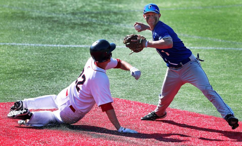 Brookline, MA: 6-11-18:Brookline's Mitch Schroeder (left) tries to break up the play as he is out on a force play at second base. The throw to first base by Braintree's Justin Adams (right) was too late and there was no double play. Brookline met Braintree in a Division One South baseball quarterfinal at Parsons Field. (Jim Davis/Globe Staff)
