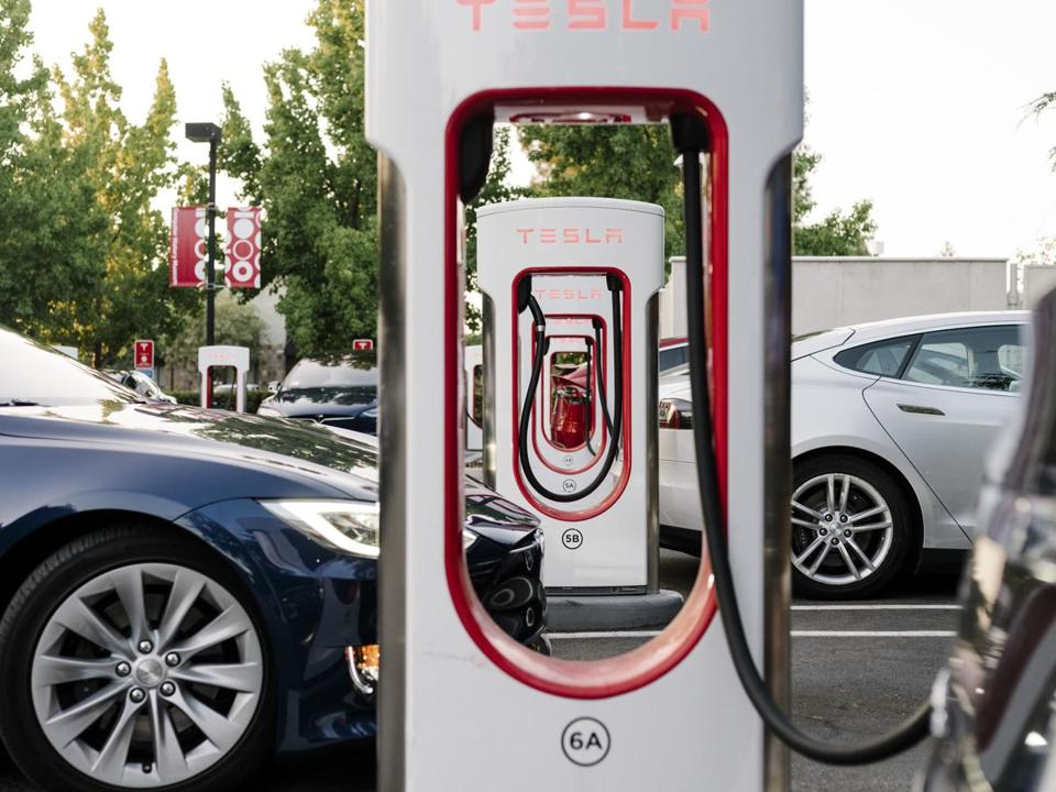 A Tesla supercharging station in Mountain View, Calif. CEO Elon Musk, noting that Tesla had never produced an annual profit since it was founded 15 years ago, said the company needs to become a sustainable money maker.