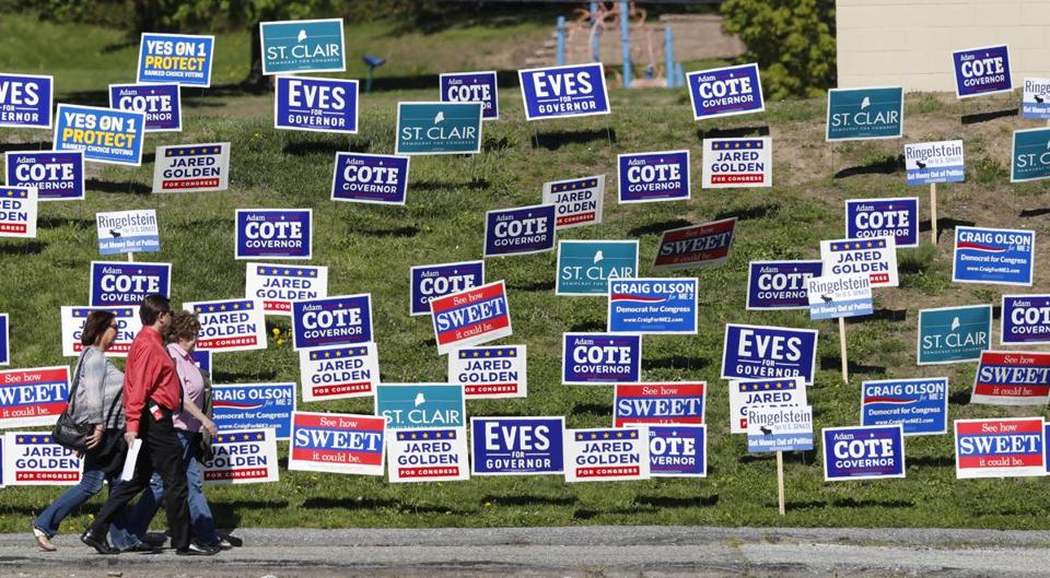 Candidate signs plastered a stretch of grass outside the the Democratic Convention last month in Lewiston, Maine.