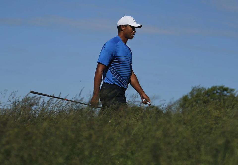 Woods blames putting for US Open misery