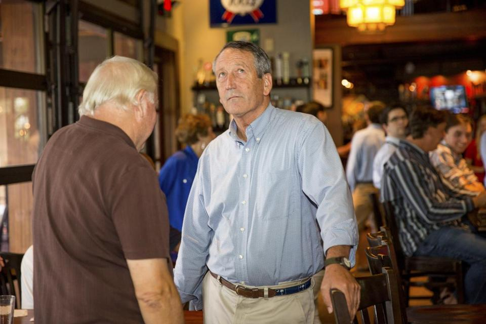 Rep. Mark Sanford (R-S.C.), who is being challenged in a primary, with supporters on primary day in Mt. Pleasant, S.C., June 12, 2018. In a strikingly personal last-minute intervention against a lawmaker of his own party, President Donald Trump attacked Sanford on Tuesday and urged voters to support the woman who is trying to unseat him in the day's primary. (Hunter McRae/The New York Times)