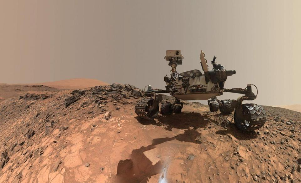 "(FILES)This NASA file photo released June 7, 2018 shows a low-angle self-portrait of NASA's Curiosity Mars rover vehicle at the site from which it reached down to drill into a rock target called ""Buckskin"" on lower Mount Sharp. NASA hosted a media teleconference on June 13,2018 to discuss a massive Martian dust storm affecting operations of the agencys Opportunity rover and what scientists can learn from the various missions studying this unprecedented event. The storm is one of the most intense ever observed on the Red Planet. As of June 10, it covered more than 15.8 million square miles (41 million square kilometers) about the area of North America and Russia combined. It has blocked out so much sunlight, it has effectively turned day into night for Opportunity, which is located near the center of the storm, inside Mars' Perseverance Valley. / AFP PHOTO / NASA / Handout / RESTRICTED TO EDITORIAL USE - MANDATORY CREDIT ""AFP PHOTO / NASA"" - NO MARKETING NO ADVERTISING CAMPAIGNS - DISTRIBUTED AS A SERVICE TO CLIENTS HANDOUT/AFP/Getty Images"