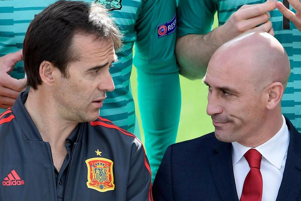 (FILES) In this file photo taken on June 5, 2018 Spain's coach Julen Lopetegui speaks with Spanish Footbal Federation (RFEF) president Luis Manuel Rubiales (R) as they pose for the official squad photo before a training session at Las Rozas de Madrid sports city. Spain sacked coach Lopetegui just two days before the team's opening game against Portugal at the World Cup, Spanish football federation chief Luis Rubiales confirmed on June 13, 2018. In a surprise announcement on June 12, Real Madrid named Lopetegui as their next manager to start work after the tournament in Russia, sparking outrage among the federation and Spanish fans at the timing of the announcement. / AFP PHOTO / JAVIER SORIANOJAVIER SORIANO/AFP/Getty Images