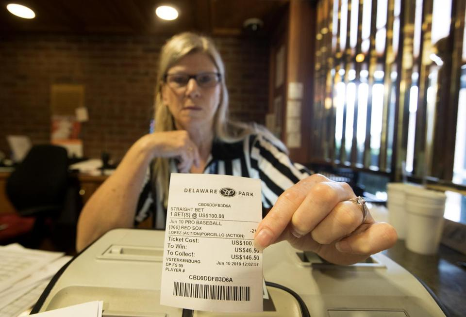A teller displays a bet on the favored Red Sox to beat the White Sox (but Chicago won, 5-2).