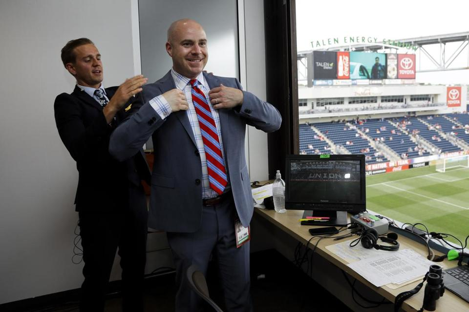 Fox Sports broadcasters Stuart Holden, left, and John Strong put on their coats for a photo before an international friendly soccer match between the United States and Bolivia, Monday, May 28, 2018, in Chester, Pa. (AP Photo/Matt Slocum)