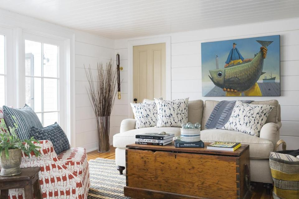 In the so-called cocktail room, the blue seaweed-patterned pillows are from Design No. Five's customizable fabric line. The antique sea captain's chest is from Eldred's auction house in East Dennis.