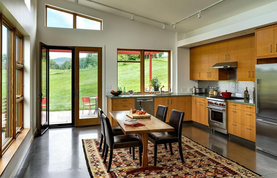 In the eat-in kitchen, views encompass the patio and surrounding countryside.