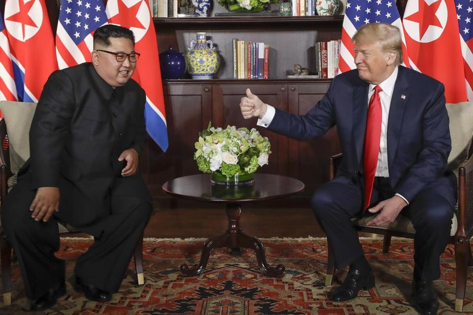 U.S. President Donald Trump gives North Korean leader Kim Jong Un a thumbs up during their meeting at a resort on Sentosa Island in Singapore on Tuesday