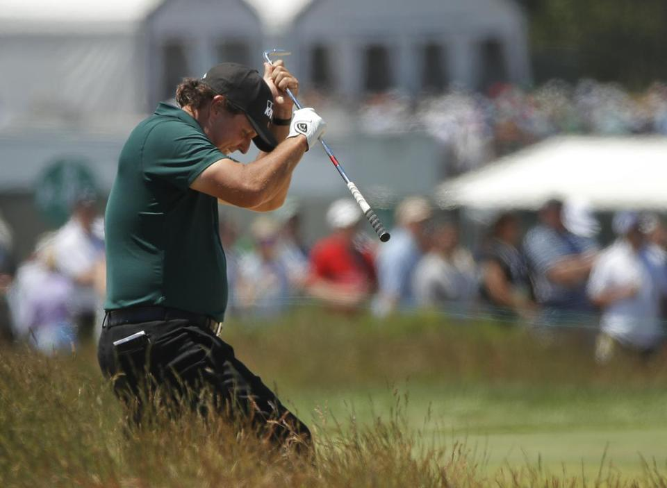 Phil Mickelson reacts to a shot from the fescue on the fifth hole during the third round of the U.S. Open Golf Championship Saturday