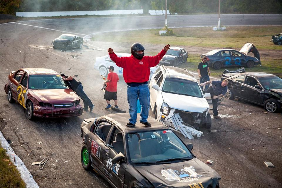 Dylan Fielding celebrates at the finish of the demolition-style Flagpole Race, held at the end of each racing day at New Hampshire's Hudson Speedway.