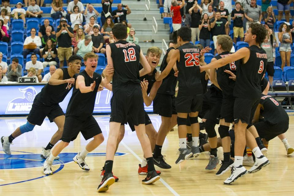 Westfield High players celebrate on the court after defeating Needham in five sets at the MIAA Boy's Division 1 volleyball championship at Worcester State University in Worcester, Massachusetts on June 21, 2018. Matthew Healey for The Boston Globe (SPORTS)