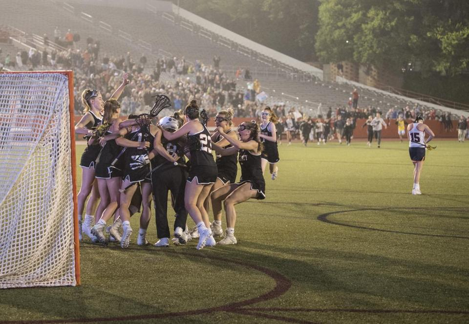 Boston, MA - 6/23/2018 - Wellesley girls lacrosse team, celebrate their victory. Walpole #15 Sydney Scales (right) Wellesley High school girls lacrosse vs Walpole high school girls lacrosse, Division I Girls. (John Cetrino for The Boston Globe) SPORTS