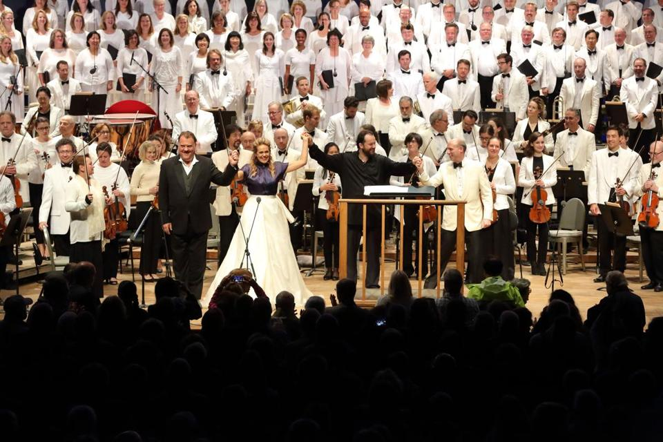 The Tanglewood Festival Chorus performing with the Boston Symphony Orchestra in August 2017. Front row, from right: New chorus conductor James Burton, BSO music director Andris Nelsons, and singers Kristine Opolais and Bryn Terfel.