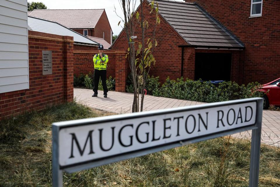Police at Muggleton Road in Amesbury where a couple, now hospitalized, was exposed to a military-grade nerve agent.