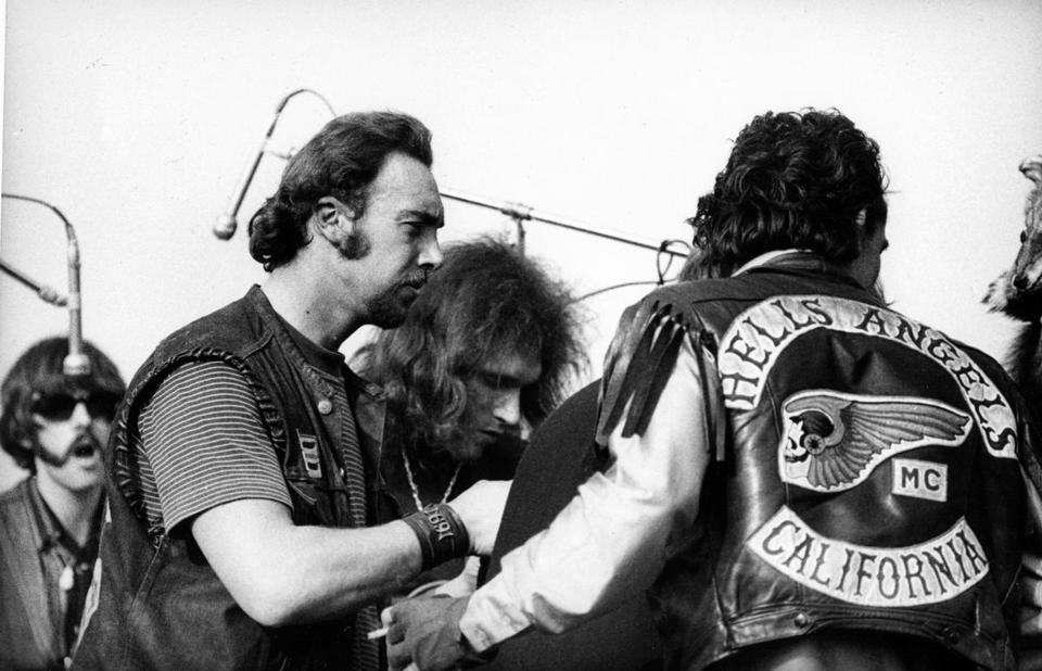 Jorma Kaukonen of the Jefferson Airplane confronts members of the Hells Angels at Altamont.