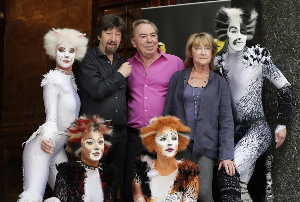 "Ms. Lynne, composer Andrew Lloyd Webber (center), and director Trevor Nunn posed with members of the cast of a revival of ""Cats"" in London in 2014."