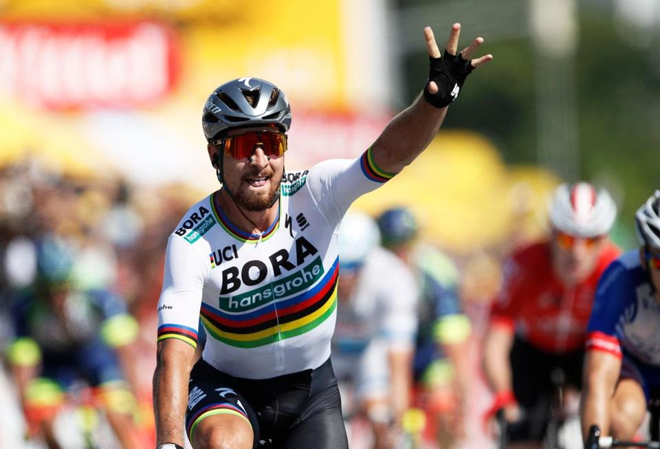 Mandatory Credit: Photo by YOAN VALAT/EPA-EFE/REX/Shutterstock (9745175g) Peter Sagan Tour de France 2018 - 2nd stage, La Roche-Sur-Yon - 08 Jul 2018 Slovakian rider Peter Sagan of the Bora Hansgrohe team celebrates as he crosses the finish line to win the 2nd stage of the 105th edition of the Tour de France cycling race over 182.5km between Mouilleron-Saint-Germain and La Roche-Sur-Yon, France, 08 July 2018.