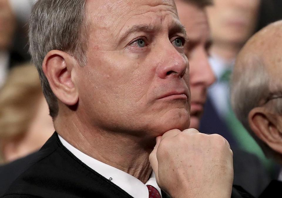 FILE - In this Tuesday, Jan. 30, 2018 file photo, U.S. Supreme Court Chief Justice John Roberts listens as President Donald Trump delivers his first State of the Union address in the House chamber of the U.S. Capitol to a joint session of Congress Tuesday in Washington.