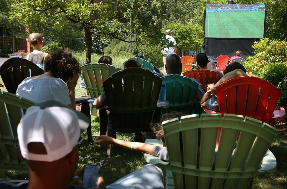 CAMBRIDGE, MA - 07/10/2018 A crowd people gathered to watch France play Belgium in the World Cup on a Jumbotron at University Park Commons. Erin Clark for the Boston Globe