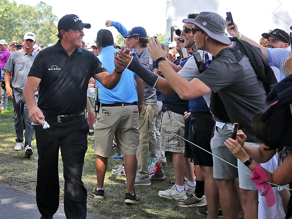 Phil Mickelson high fived fans as he walked off the 16th green during the second round of the Dell Technologies Championship at the TPC Boston in 2017.