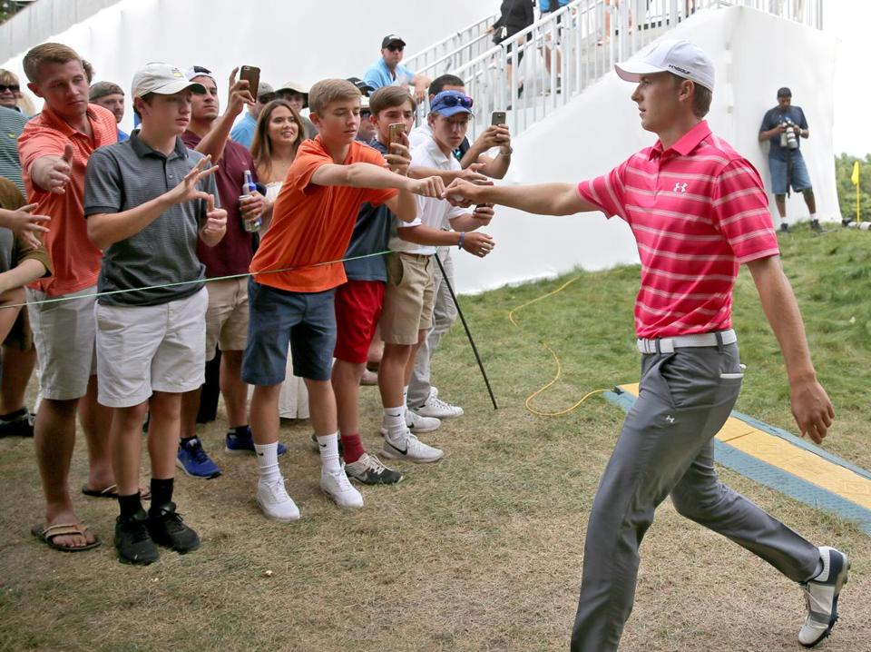Jordan Spieth greeted fans as he walked off the 9th green during the second round of the Dell Technologies Championship at the TPC Boston in 2017.