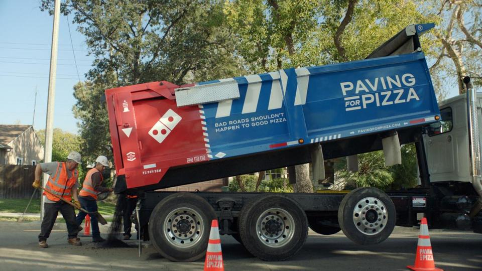 Domino's is giving cities and towns grants to fix potholes — and Lowell wants in.