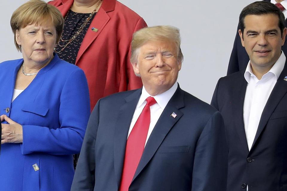 German Chancellor Angela Merkel left US President Donald Trump and Greek Prime Minister Alexis Tsipras pose for a family