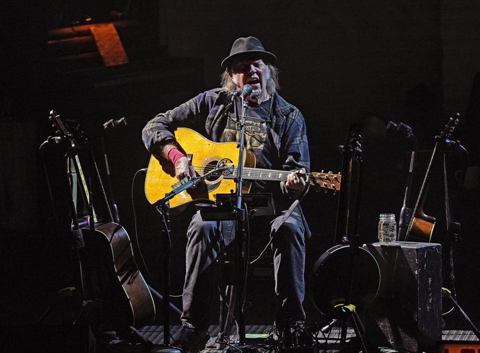 Neil Young performs solo at the Boch Center Wang Theatre.