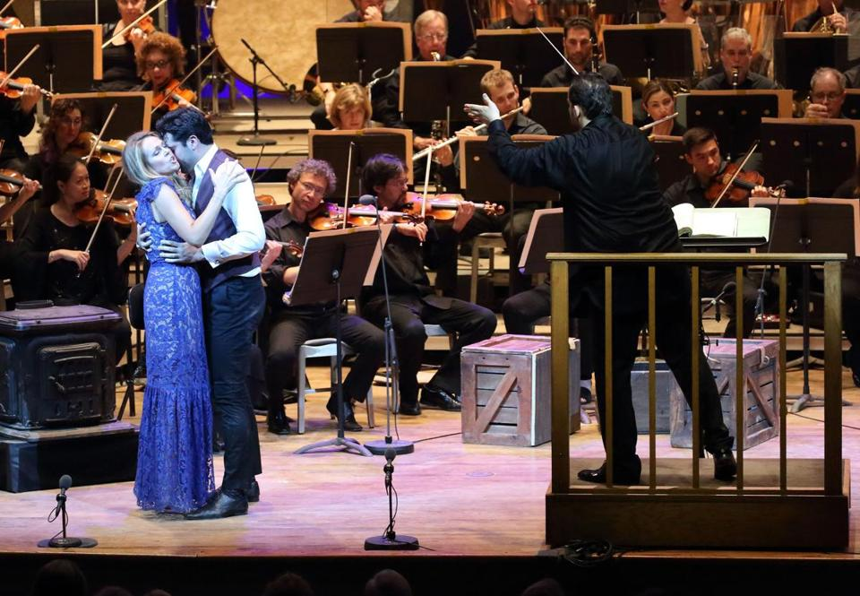 "Kristine Opolias and Jonathan Tetelman in ""La Bohème,"" with Andris Nelsons (right) and the Boston Symphony Orchestra."