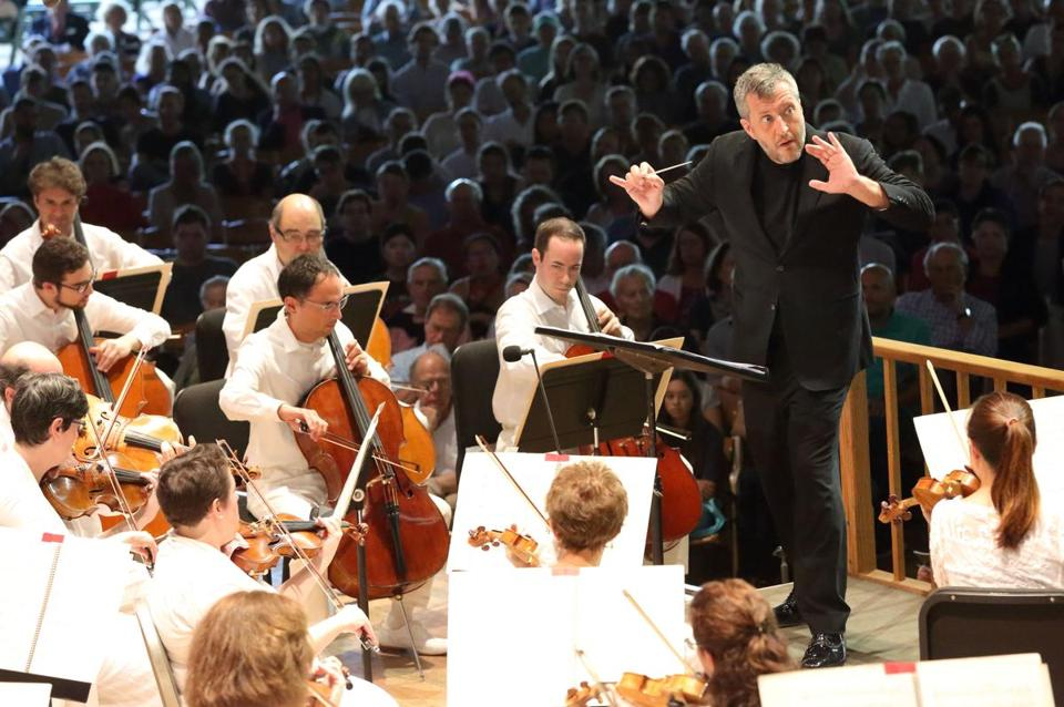 "BSO artistic partner Thomas Adès (left) led the orchestra in his ""Powder Her Face"" Suite. on Sunday."