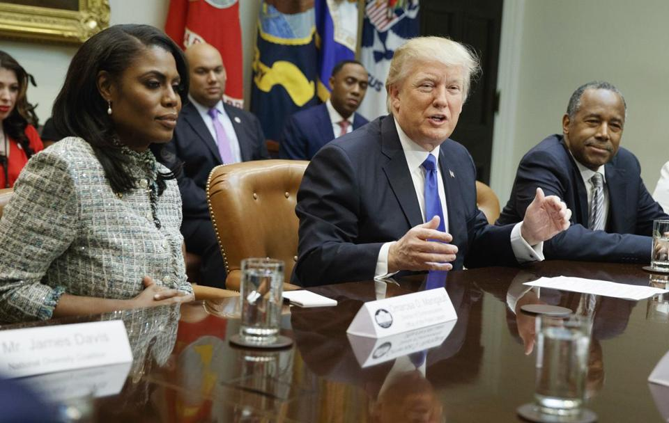 Omarosa Manigault-Newman with President Trump and then-Housing and Urban Development Secretary-designate Ben Carson (far right) at the White House in February 2017.