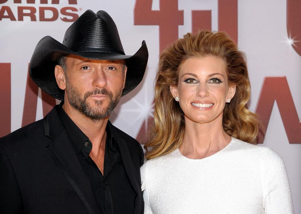 NASHVILLE, TN - NOVEMBER 09: Tim McGraw and Faith Hill attend the 45th annual CMA Awards at the Bridgestone Arena on November 9, 2011 in Nashville, Tennessee. (Photo by Michael Loccisano/Getty Images)