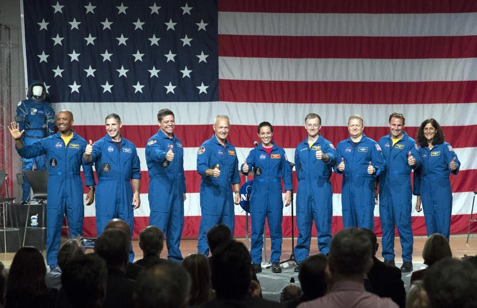 From left to right Astronauts Victor Glover Michael Hopkins Robert Behnken Douglas Hurley Nicole Mann Christopher Ferguson Eric Boe Josh Cassada and Sunita Williams gave a thumbs up to the crowd