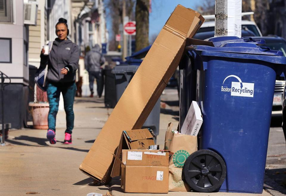 Cardboard boxes from online shopping stack up at H Street in South Boston.